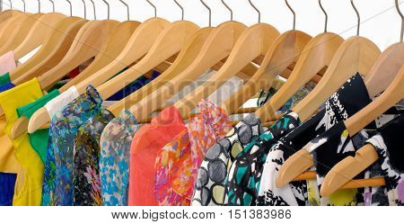Set of Female colorful summer clothes isolated on hanging