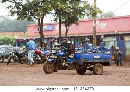 AFRICA, TANZANIA, MAY, 09, 2016 - Typical street scene in Arusha. A series of motobikes are parked in front of the citys local. Arusha is located below Mount Meru in the eastern branch of the Great Rift Valley and the capital of the Arusha Region.