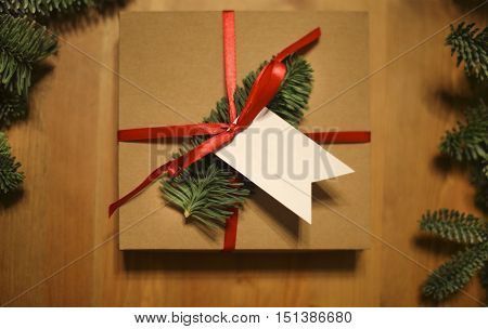 Christmas presents laid on a wooden table background. Cristmas concept