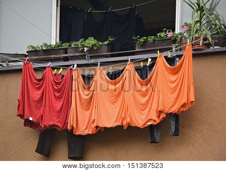 Drying freshly washed laundry on a clothesline outside the window