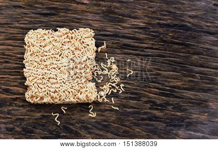Instant noodles on wood for design and background.