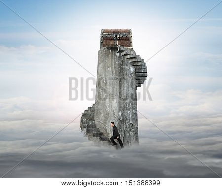 Businessman Climbing Spiral Staircase Toward Treasure Chest On Tower