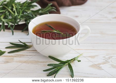 Rosemary Tea And Milk Jar On Wooden Table.
