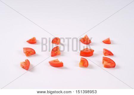 sliced ripe tomatoes arranged on white background
