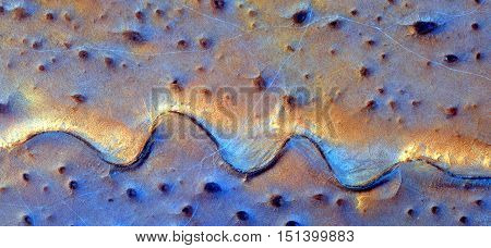landscape sunrise in the desert, wavy lines, bright golden sand on turquoise background, photo landscapes deserts of Africa from the air, Tribute to Van Gogh. l