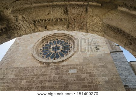 Tarragona (Catalunya Spain): exterior of the gothic cathedral seen through an arch of another gothic building