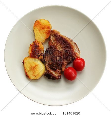 Roasted meat and potato and tomato at the plate