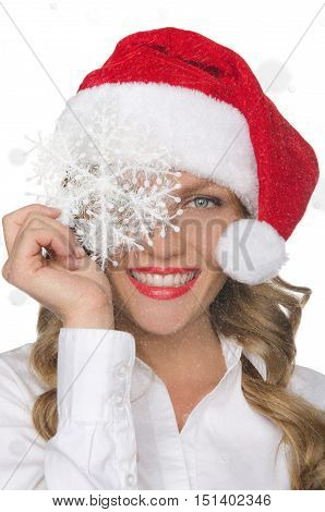 smiling woman in Santa hat with snowflakes isolated on white