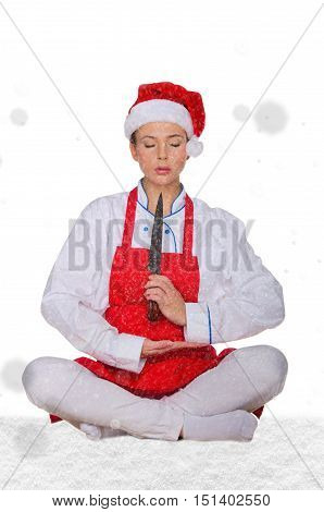 Cook in Santa hat yoga knife under snow on white background