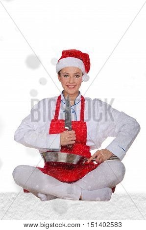 Woman cook in Santa Claus hat yoga knife under snow on white background