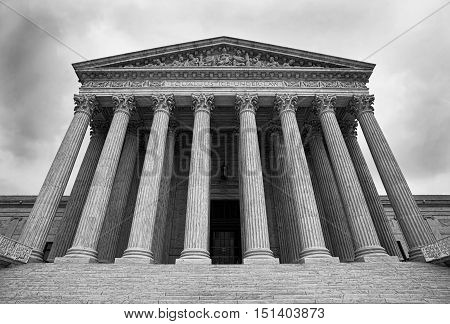 The Supreme Court building in Washington DC. in black and white.