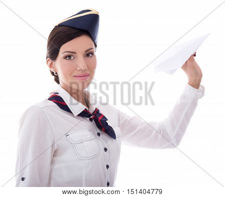 Portrait Of Young Stewardess With Paper Plane Isolated On White