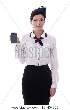 Young Stewardess Holding Smart Phone With Blank Screen Isolated On White