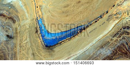 boomerang blue in the desert, .abstract landscapes, abstract photography deserts of Africa from the air,