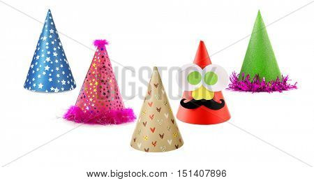 Colorful party caps on white background