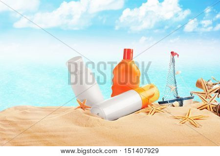 Accessories for tanning on beach on sea and sky background
