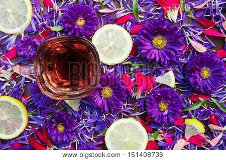 background cup of tea and slices of lemon flowers