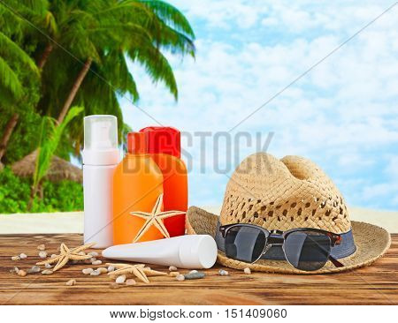 Sun protection set on tropical beach and blue sky background