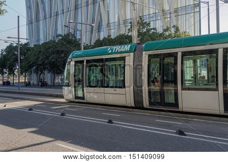 Barcelona, Spain - 25 September 2016: Tram Transport in Barcelona, Spain.  Tram line T4, part of Trambesos network, at a stop in the Forum area.