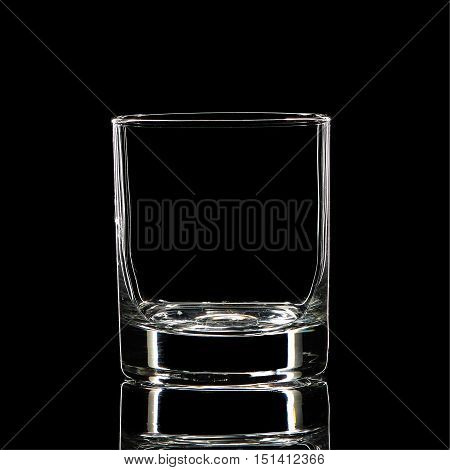 Silhouette of white strong liquor classic glass with clipping path on black background.