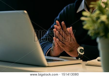Hands of business person working on laptop late at night