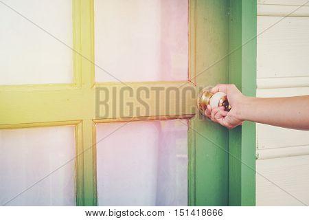 Human's hand open door knob vintage tone