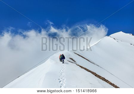 Group of climbers goes down from the top of Erciyes volcano. Turkey