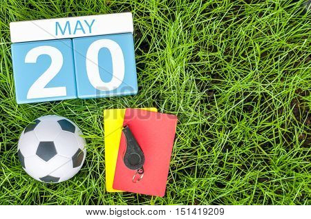 May 20th. Day 20 of month, calendar on football green grass background. Spring time, empty space for text.