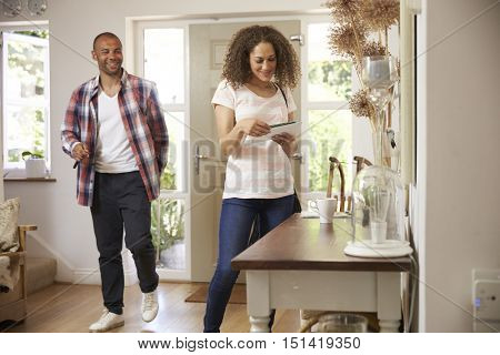 Couple In Hallway Returning Home Together