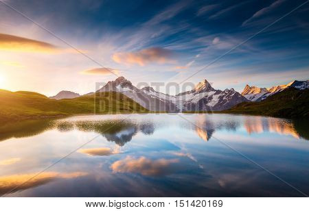 Alpine view of the Mt. Schreckhorn and Wetterhorn. Popular tourist attraction. Dramatic and picturesque scene. Location place Bachalpsee in Swiss alps, Grindelwald valley, Europe. Beauty world.