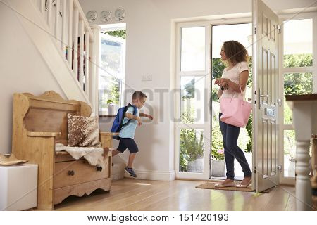 Boy Leaving Home For School With Mother