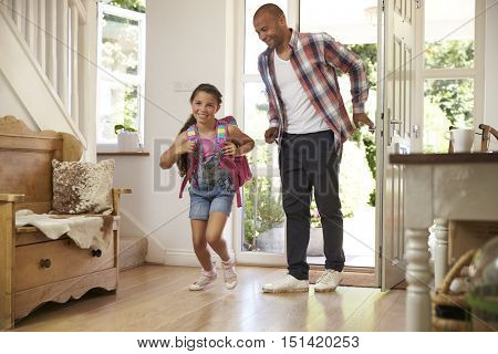 Excited Girl Returning Home From School With Mother