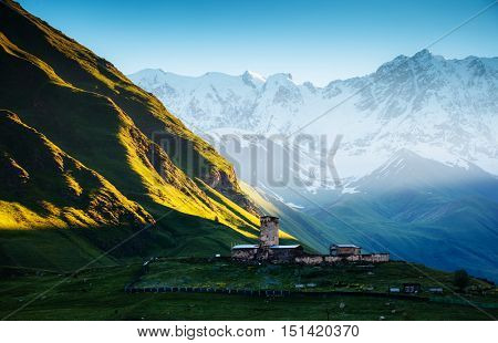 View of the Ushguli village at the foot of Mt. Shkhara. Picturesque and gorgeous scene. Famous tourist attraction. Location place Lamaria Church Jgrag, Upper Svaneti, Georgia, Europe. Beauty world.