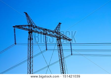 Large electric support on the sky background