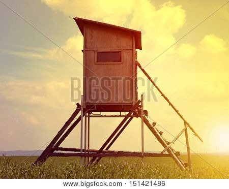 Lookout tower for hunting on meadow