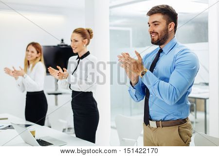 Business people clapping hands at meeting  in the conference room