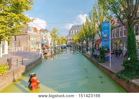 Delft, The Netherlands - August 30, 2016: The original composition of horses drowning in the urban canal. One of the city's attractions.