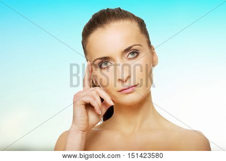 Beautiful thoughtful woman with make up.