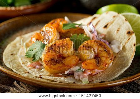 Delicious spicy shrimp taco with creamy cilantro slaw and lime.