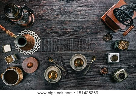 Metal vintage cups for coffee and accessories for coffee making on the wooden table. Flat lay