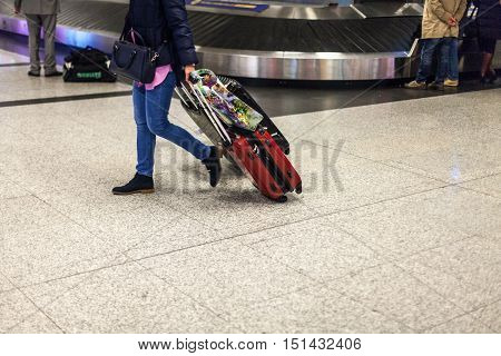 Closeup of a Person Carrying Luggage in an Airport