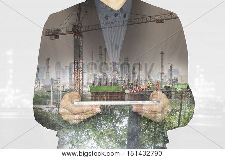 business working on tablet.Green nature environment tecnology factory industry to concept.Urban city lifestyle. Double exposure layers multiplys business concept.