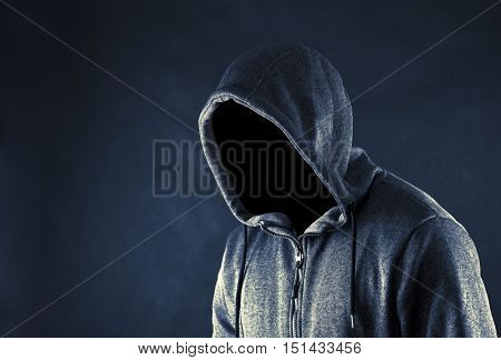 Hooded man in the dark