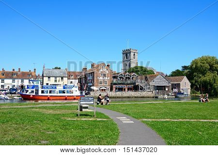 WAREHAM, UNITED KINGDOM - JULY 19, 2016 - Boats on the river with views towards The Old Granary and Lady St Mary church Wareham Dorset England UK Western Europe, July 19, 2016..