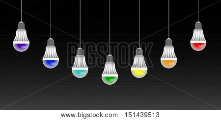 garland of colored LED lamps on a black striped background