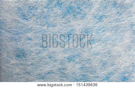Grey fiber fabric and blue glitter film, background