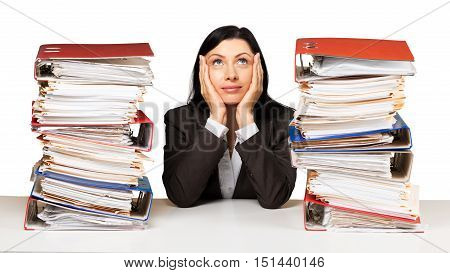 Portrait of an Employee Behind a Stack of Folders Looking Up