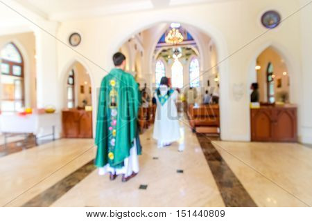 Blurred Priest And Christian Mass Praying Inside The Church
