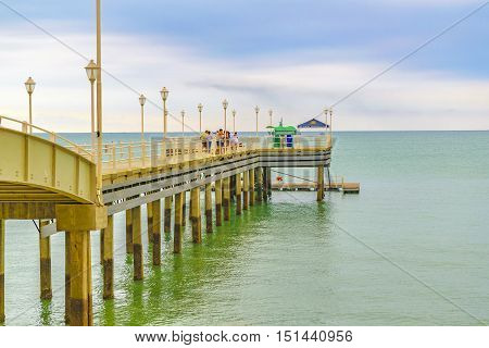 SALINAS, ECUADOR, OCTOBER - 2015 - Perspective view of breakwater walkway at beach in Salinas Ecuador