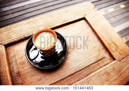 piccolo latte on wooden table in morning